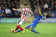 AFC Wimbledon midfielder Tom Soares (19) tackling Lincoln City defender Neil Eardley (23) during the The FA Cup match between AFC Wimbledon and Lincoln City at the Cherry Red Records Stadium, Kingston, England on 4 November 2017. Photo by Matthew Redman.