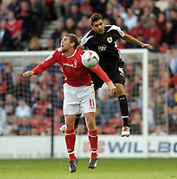 Photo: Leigh Quinnell.<br /> Nottingham Forest v Bristol City. Coca Cola League 1. 21/10/2006. Bristol Citys Liam Fontaine jumps into Forests Grant Holt.