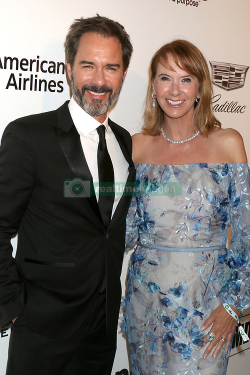 February 24, 2019 - West Hollywood, CA, USA - LOS ANGELES - FEB 24:  Eric McCormack, Janet McCormack at the Elton John Oscar Viewing Party on the West Hollywood Park on February 24, 2019 in West Hollywood, CA (Credit Image: © Kay Blake/ZUMA Wire)