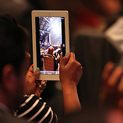 An attendee uses an electronic tablet as he watches President Barack Obama speak at the NALEO (National Association of Latino Elected and Appointed Officials) conference at the Disney Contemporary Resort Convention Center in Lake Buena Vista, Fla. on Friday, June 22, 2012. (AP Photo/Alex Menendez) President Barack Obama speaks in Orlando, Florida.