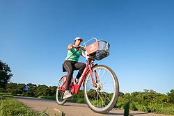 Cyclist on the Trinity Trails near the Trinity River, Fort Worth, Texas, USA.