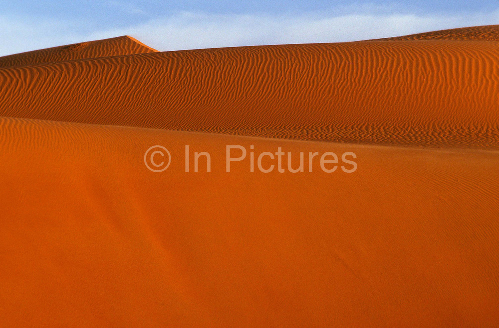 """Sand dunes, surrounding Chinguetti, Mauritania, once one of Islam's holiest cities (today it is regarded as the seventh holiest city) it has been dated at a around seven hundred, (700) years old and is famed for it's Koranic libraries and distinctive mosque, Mauritania. From the story """"The Wind and the City""""."""