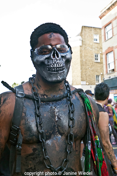 Jab Jab followers dancing and celebrating at Notting Hill Carnival in 2017  London UK. Before emancipation, slaves were forbidden to participate in Carnival, but this never stopped their backyard mas. After the end of slavery, gangs of recently liberated slaves, covered in black grease, molasses, or varnish, took to the streets, and rejoiced in their freedom.