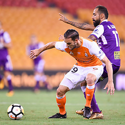 BRISBANE, AUSTRALIA - DECEMBER 21: Jack Hingert of the Roar is tackled by Diego Castro of the Glory during the Round 12 Hyundai A-League match between Brisbane Roar and Perth Glory on December 21, 2017 in Brisbane, Australia. (Photo by Patrick Kearney / Brisbane Roar FC)