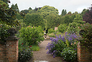 Decorative urns and ccampanula at the entrance to  the walled Autumn Garden at Newby Hall, Ripon, Yorkshire, UK