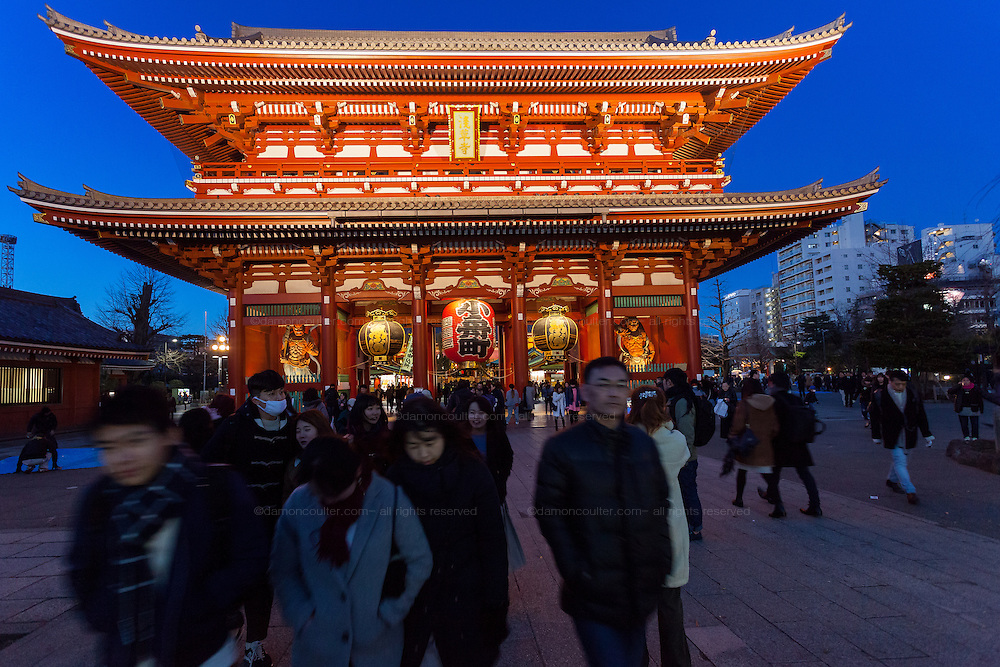 Tourists visiting an illuminated Senso ji temple, Asakusa, Tokyo, Japan. Thursday January 5th 2017