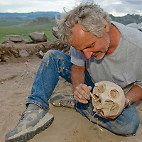 Smithsonian archaeologist & forensics specialist, Dr. Bruno Frohlich, unearths a bronze-age skull at an archaeology site above the Delger River near Muren, Mongolia. This  may be 2700+ years old.