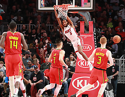 January 6, 2019 - Atlanta, GA, USA - Miami Heat forward Derrick Jones Jr. slams for two over Atlanta Hawks defenders Jeremy Lin and Kevin Huerter during the first half on Sunday, Jan. 6, 2019 at State Farm Arena in Atlanta, Ga. (Credit Image: © Curtis Compton/Atlanta Journal-Constitution/TNS via ZUMA Wire)