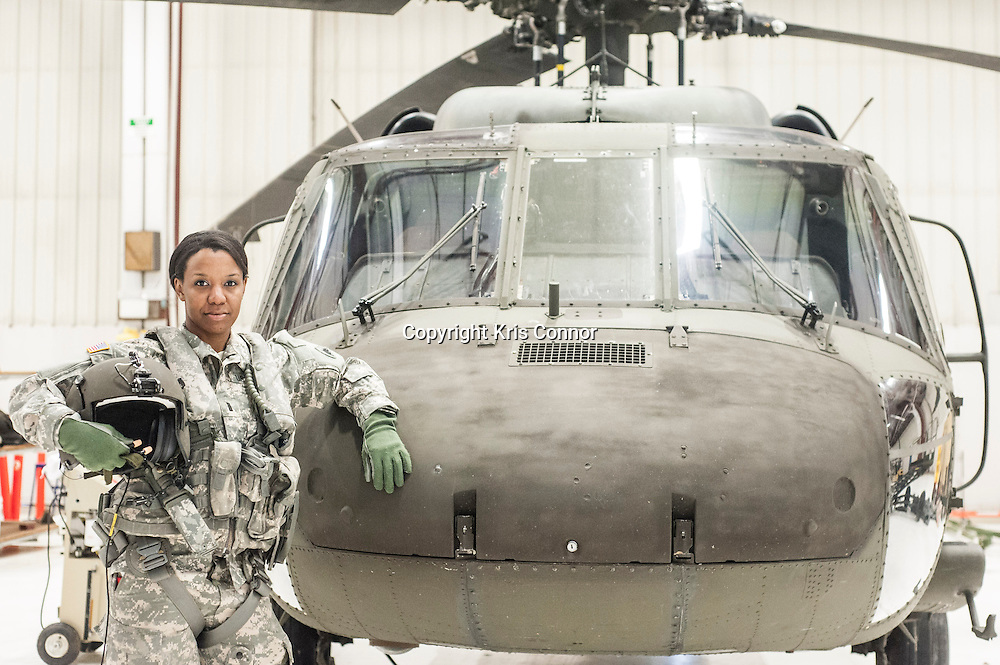 First Lieutenant Dina Elosiebo of Memphis, TN poses with a Washington DC National Guard UH-60 BlackHawk at Davison Army Airfield in Fort Belvoir, Va on April 15th, 2014. Elosiebo is the first female black helicopter pilot in the Washington DC National Guard. Photo by Kris Connor<br /> <br /> Wider edit available at http://krisconnor.photoshelter.com/gallery/Profile-Dina-Elosiebo/G0000l.3OlsWl4xE/C0000XX9_zBFm2aY
