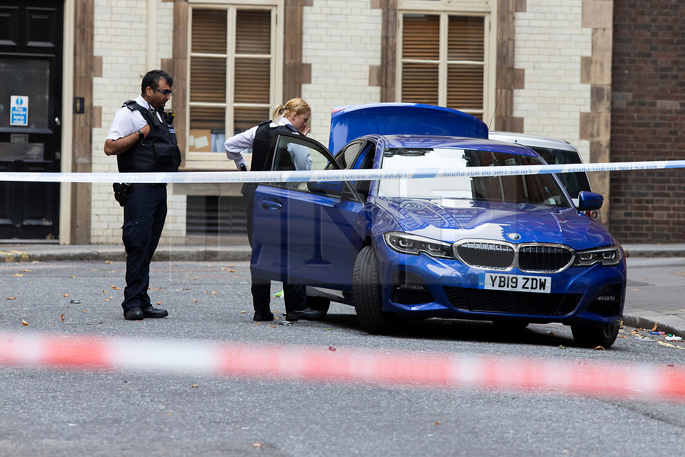 © Licensed to London News Pictures. 28/07/2019. London, UK. Police Officers inspect a car in a crime scene on Savoy Hill after a man suffered stab wounds during a mass brawl on Victoria Embankment in the early hours of this morning. One man was arrested for possession of an offensive weapon while five other men were arrested for violent disorder . Photo credit: George Cracknell Wright/LNP