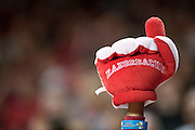 Nov 16, 2011; Fayetteville, AR, USA;  Arkansas Razorback fan holds up a stuffed number-one hand during a game against the Oakland Grizzlie at Bud Walton Arena. Arkansas defeated Oakland 91-68. Mandatory Credit: Beth Hall-US PRESSWIRE