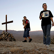 PALM DESERT, CA, OCTOBER 21, 2006: Louisa Prudhomme, mother of Anthony Prudhomme who was the murder victim in a hate crime by Latino gang members in Highland Park, CA, regularly visits the site (with her remaining son) where she buried her son's ashes. Located about 150 miles from her home, Anthony's ashes lay buried beneath a cross high atop a hill overlooking the Coachella Nature Preserve. This was a favorite spot for Anthony. (Photograph by Todd Bigelow/Aurora).