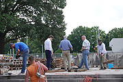 Workmen remove a pedestal, on June 2, 2021, that once held a statue of Confederate general and early member of the Ku Klux Klan (KKK), Nathan Bedford Forrest. The statue, that was removed after protests in December 2017, stood over his grave in Health Sciences Park in Memphis, Tennessee, U.S. The remains of Forrest and his wife below the base will be moved to Columbia, Tennessee.