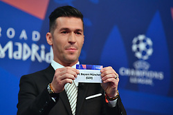 NYON, SWITZERLAND - Monday, December 17, 2018: Former Liverpool player and Champions League winner Luis Garcia holds up Bayern Munich, to face Liverpool, after making the draw during the UEFA Champions League 2018/19 Round of 16 draw at the UEFA House of European Football. (Handout by UEFA)
