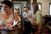 Curtis Hice, 27, (centre-right) is talking to members of his community church with his wife (centre-left) in Winchester, Tennessee, where he works at Social Security office. He lives with his wife and 2-year-old daughter. Curtis was a Marine combat engineer and fought during the first battle for Fallujah. After returning to the USA, he became more devoted and turned into religion. He is now the solo singer at this church..