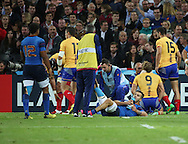 Sofiane Guitoune (France) getting treatment after injuring himself scoring a try during the Rugby World Cup Pool D match between France and Romania at the Queen Elizabeth II Olympic Park, London, United Kingdom on 23 September 2015. Photo by Matthew Redman.