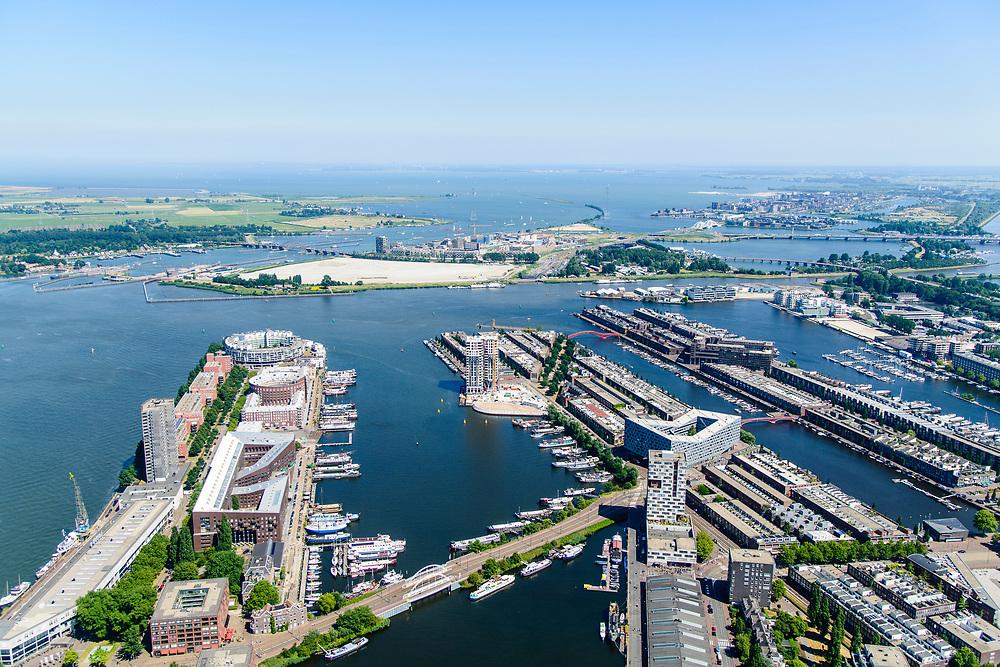 Nederland, Noord-Holland, Amsterdam, 29-06-2018; Zeeburg, voormalige Stadsrietlanden. KNSM eiland met Verbindingsdam (linksonder), Sporenburg, Borneo-eiland, Ertshaven, Entrepothaven. Zeeburgereiland en IJburg in het verschiet.<br /> Former eastern port area, now residential area.<br /> <br /> luchtfoto (toeslag op standard tarieven);<br /> aerial photo (additional fee required);<br /> copyright foto/photo Siebe Swart
