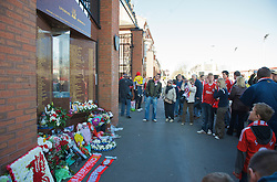 LIVERPOOL, ENGLAND - Saturday, April 11, 2009: Liverpool supporters pay their respects at the memorial to the 96 supporters who lost their lives at the Hillsborough Stadium Disaster on 15th April 1989. Twenty years on the victims families are still waiting for justice as none of the police officers responsible for the deaths of so many supoporters have ever been brought to justice. (Photo by: David Rawcliffe/Propaganda)