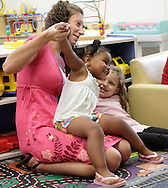 Infant-toddler teacher Melanie Heller helps Aviana Diaz-Brown during a sing-along as Lisa Munoz, right, looks on during the Early Head Start Program at Sullivan County Head Start in Woodbourne on Tuesday, July 23, 2013.