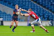 Jaco van der Walt (#10) of Edinburgh Rugby tries to escape the clutches of Romain Briatte (#6) of SU Agen Rugby during the European Rugby Challenge Cup match between Edinburgh Rugby and SU Agen at BT Murrayfield, Edinburgh, Scotland on 18 January 2020.