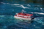 Sightseeing boat approaches Horseshoe Falls, Niagra Falls, Ontario, Canada