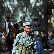 A member of the Afghan National Police stands guard in front of the women's school where a water filtration demonstration given by Waves For Water and the US Military in the village of Nari, Kunar Province of Eastern Afghanistan.