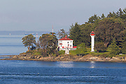The Georgina Point Lighthouse sits at the northern tip of Mayne Island in British Columbia, Canada. It marks the eastern entrance to Active Pass, and as a result, it's also known as the Active Pass Lighthouse. The pass, a channel between Mayne and Gabriola islands, is a main route for ferries between Canada's mainland and Vancouver Island. The original lighthouse at this point was established in 1885. The current lighthouse, built in 1940, was decommissioned in 1969. It is now part of the Parks Canada Gulf Islands National Park Reserve.