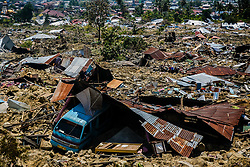 October 2, 2018 - Palu, Indonesia - Debris of houses in Balaroa village in palu after the deadly earth quake and tsunami in Central Sulawesi, Indonesia. Over 1,234 people were killed in Palu, Donggala district, Parigi Mountong district and North Mamuju district, according to the Disaster Management Institute of Indonesia, Care for Humanity and the Humanity Data Center. (Credit Image: © Iqbal Lubis/Xinhua via ZUMA Wire)