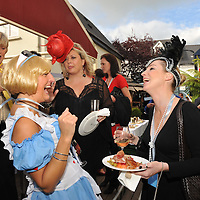 Partygoers at the Mad Hatters Tea Party enjoy the food in Hamlets Bar in Kinsale during the Gourmet Festival.