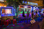 People drinking at market stall cocktail bars on Pub Street in downtown Siem Reap, Cambodia, Asia. Siem Reap is the capital city of the Siem Reap Province.  Pub Street is a famous destination for lively nightlife for tourist and travellers as it restaurants and bars stay open late.  (photo by Andrew Aitchison / In pictures via Getty Images)
