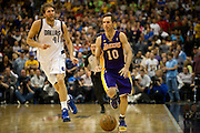 Steve Nash (10) of the Los Angeles Lakers brings the ball up the court past Dirk Nowitzki (41) of the Dallas Mavericks at the American Airlines Center in Dallas on Sunday, February 24, 2013. (Cooper Neill/The Dallas Morning News)