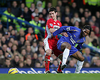 Photo: Lee Earle.<br /> Chelsea v Middlesbrough. The Barclays Premiership.<br /> 03/12/2005. Chelsea's Didier Drogba (R) clashes with Chris Riggott.