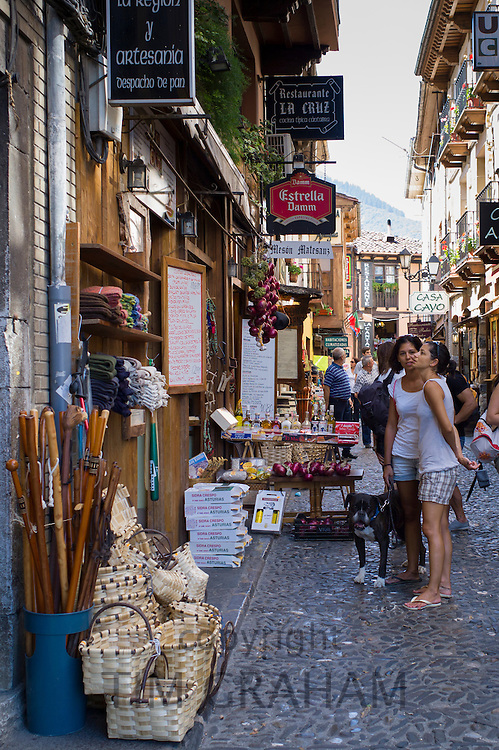 Tourists shopping in town of Potes in valley of the Picos de Europa, Cantabria, Northern Spain