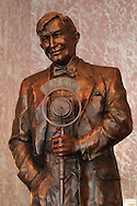 Statue by Sandra Van Zandt of Will Rogers at microphone doing 1930s radio show; lobby of Will Rogers Hotel in downtown Claremore, Oklahoma.