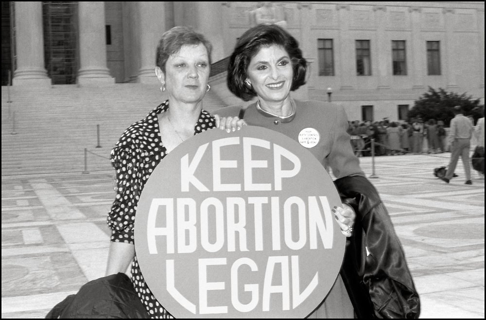 """Norma McCorvey and her attorney, Gloria Allred, attended, on April 26, 1989, as abortion rights opponents, backed by the Bush Administration, urged the Supreme Court to overturn Roe v. Wade in Webster v. Reproductive Health Services. <br /> <br /> Norma McCorvey, better known by the legal pseudonym """"Jane Roe"""", was the plaintiff in the landmark American legal case Roe v. Wade in which the U.S. Supreme Court ruled in 1973 that individual state laws banning abortion were unconstitutional.<br /> <br /> Gloria Rachel Allred is a women's rights attorney known for taking high-profile and often controversial cases, particularly those involving the protection of women's rights.<br /> <br /> In Webster v. Reproductive Health Services, the Court upheld several provisions of a Missouri law that regulated the performance of abortions. The Court refused to invalidate the law's preamble stating that life begins at conception."""