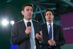 © Licensed to London News Pictures . 12/05/2014 . Manchester , UK . Andy Burnham and Ed Miliband during a Q&A session following the speech . The leader of the Labour Party , Ed Miliband delivers a speech and Q&A on health at the National Squash Centre in Manchester today (Monday 12th May 2014) . Photo credit : Joel Goodman/LNP