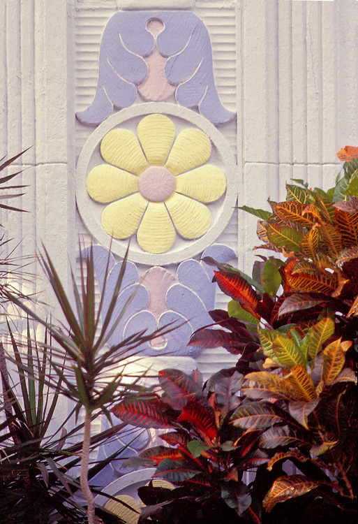 A semi-classical, Tropical Deco bas-relief on the exterior wall of a small Miami Beach apartment house designed by architect Henry Hohauser in 1939