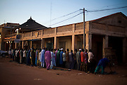 Men praying on the streets of Mopti. At the confluence of the Niger and the Bani rivers, between Timbuktu and Segou, Mopti is the second largest city in Mali, and the hub for commerce and tourism in this predominantly muslim west-african landlocked country.