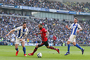 Southampton midfielder Nathan Redmond (22) battles with Brighton and Hove Albion defender Shane Duffy (4) during the Premier League match between Brighton and Hove Albion and Southampton at the American Express Community Stadium, Brighton and Hove, England on 30 March 2019.