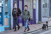 April 6, 2020, London, England, United Kingdom: Two young people walking a dog in Brighton city centre on Monday, April 6, 2020, as British Prime Minister Boris Johnson, was moved to intensive care after his coronavirus symptoms worsened in London. Johnson was admitted to St Thomas' hospital in central London on Sunday after his coronavirus symptoms persisted for 10 days. Having been in the hospital for tests and observation, his doctors advised that he be admitted to intensive care on Monday evening. (Credit Image: © Vedat Xhymshiti/ZUMA Wire)