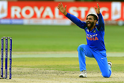 September 21, 2018 - Dubai, United Arab Emirates - Indian cricketer Ravindra Jadeja appeals successfully during the 1st cricket match of the Super four group  of Asia Cup 2018 between India and Bangaldesh at Dubai International cricket stadium,Dubai, United Arab Emirates on 21 September 2018. (Credit Image: © Tharaka Basnayaka/NurPhoto/ZUMA Press)