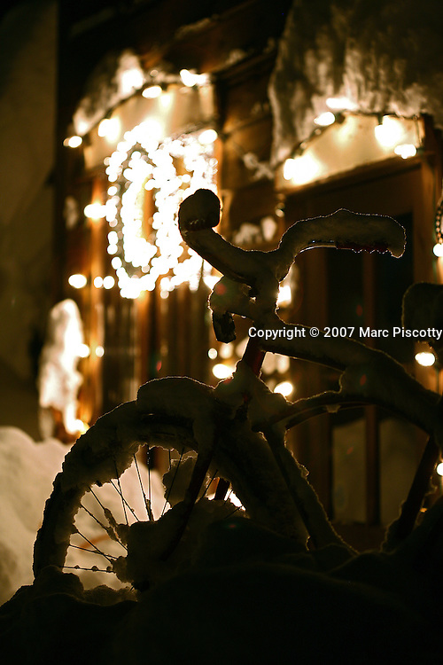 """SHOT 12/6/2007 - Images of the start of an epic season of snow in 2007 and 2008 in the town of Crested Butte, Co. A bicycle is covered in snow on Elk Avenue in the start of what would become one of the best seasons of snow on record for the ski town. A former coal mining town now called """"the last great Colorado ski town"""", Crested Butte is a popular destination for skiing, mountain biking, and a variety of other outdoor activities. The town also features Elk Avenue, an historic main street where much of the shopping and dining is located. The primary winter activity in Crested Butte is skiing or snowboarding at nearby Crested Butte Mountain Resort in Mount Crested Butte, Colorado.(Photo by Marc Piscotty/ © 2007)"""