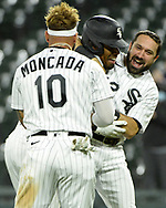 CHICAGO - APRIL 12:  Adam Eaton #12 and Yoan Moncada #10 celebrate with Nick Williams #5 of the Chicago White Sox after Willams drove in the game winning run in the bottom of the ninth inning against the Cleveland Indians on April 12, 2021 at Guaranteed Rate Field in Chicago, Illinois.  (Photo by Ron Vesely) Subject:  Adam Eaton; Yoan Moncada; Nick Williams