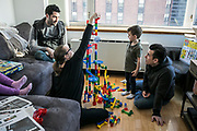 MANHATTAN, NEW YORK. JANUARY 14TH, 2018.- Big marble run constructions after lunch.<br /> <br /> Sunday routine with Jeremy Lyman and Paul Schlader, friends and co-founders of Birch Coffee  a New York City born and bred specialty coffee company. <br /> <br /> Jeremy Lyman, 38, lives in East Harlem with his two female pitbulls, Maki, 10, and Juna, 7. Paul Schlader, 39, lives on the Upper East Side with his wife Kara, 35, the head of accounts payable for Birch Coffee, and their two children, Ava, 6, and Wesley, 3.<br /> <br /> (photo EDU BAYER)