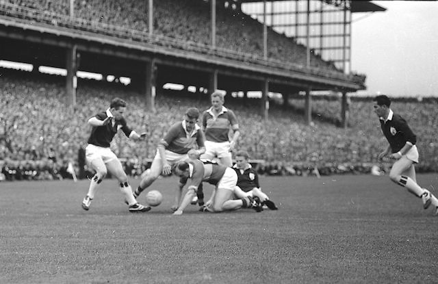 Kerry's N. Sheehy looses the ball to a Galway forward during the All Ireland Senior Gaelic Football final Kerry v. Galway in Croke Park on 27th September 1964.