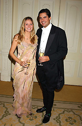 MISS KATE SHAND and MR EDWARD TAYLOR at a dinner hosed by Moet & Chandon at their headquarters at 13 Grosvenor Crescent, London on 12th October 2005.<br /><br />NON EXCLUSIVE - WORLD RIGHTS