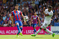 Joel Ward of Crystal Palace plays a pass over the head of Martin Olson of Swansea City (r). <br /> Premier League match, Crystal Palace v Swansea city at Selhurst Park in London on Saturday 26th August 2017.<br /> pic by Kieran Clarke, Andrew Orchard sports photography.
