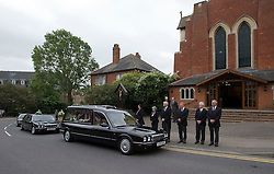 © licensed to London News Pictures. 18/05/2011. Tonbridge, UK. The funeral cortege of heavyweight boxing legend Sir Henry Cooper arriving at Corpus Christi Church in Lyons Crescent, Tonbridge, Kent today (18/05/2011).  Please see special instructions for usage rates. Photo credit should read Ben Cawthra/LNP