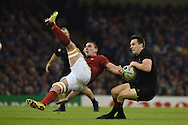 Louis Picamoles of France (l) jumps for a high ball with Ben Smith of New Zealand leading to the Frenchman falling on the ground and New Zealand go on to score another try in the corner. Rugby World Cup 2015 quarter-final match, New Zealand v France at the Millennium Stadium in Cardiff, South Wales  on Saturday 17th October 2015.<br /> pic by  Andrew Orchard, Andrew Orchard sports photography.