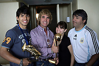 """SERGIO KUN AGUERO - WORLD CUP U20 CHAMPION with ARGENTINA  - BEST PLAYER - and TOP SCORER with the trophy in his room, a day after win the final match over Czech Republic 2-1<br /> Here with his """"padrino"""" DARIO FERNANDEZ -  his sister JESYCA and his father LEONEL AGUERO - <br />  Toronto, Canada 23/07/07<br /> © Gabriel Piko / PikoPress"""
